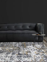 Maxim modern handknot rug design in black, gold and grey lifestyle living room shot