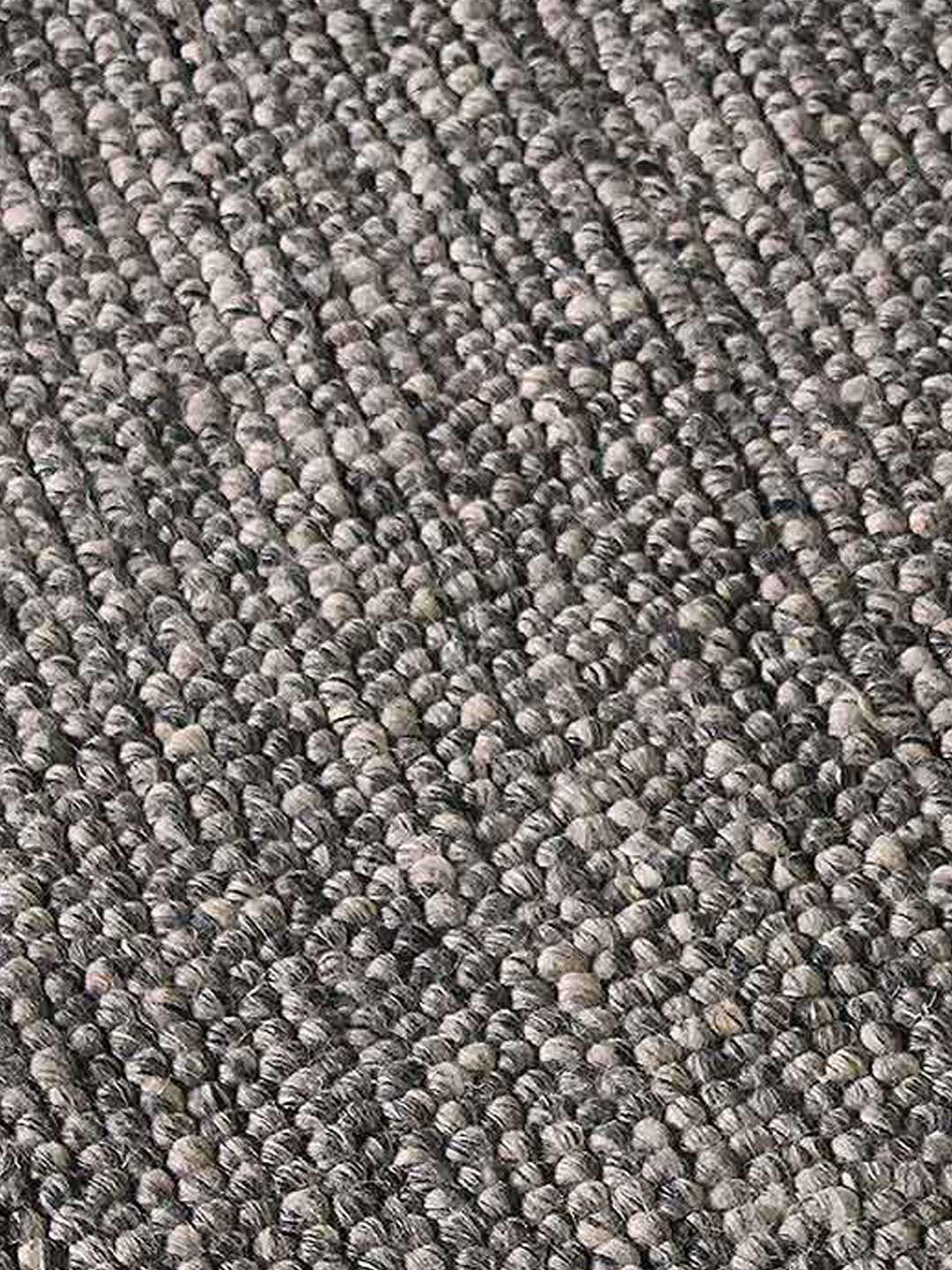 Fizzle textured loop pile rug in natural warm grey tones close up image