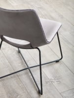 Baxter dining chair in concrete grey leather colour back angle view