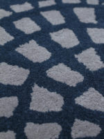Cobblestone navy blue and grey handtufted wool rug close up