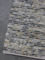 Magic Mineral grey and yellow ochre textured rug collection corner image