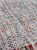 Bijou handwoven multi colour rug with fringe corner and rug close up image