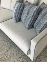 Camille 3 seater Sofa in felted wool fabric detail of arm with contrast piping